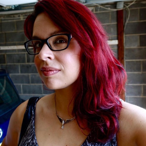 Olivia Durant red hair eye surgery glasses